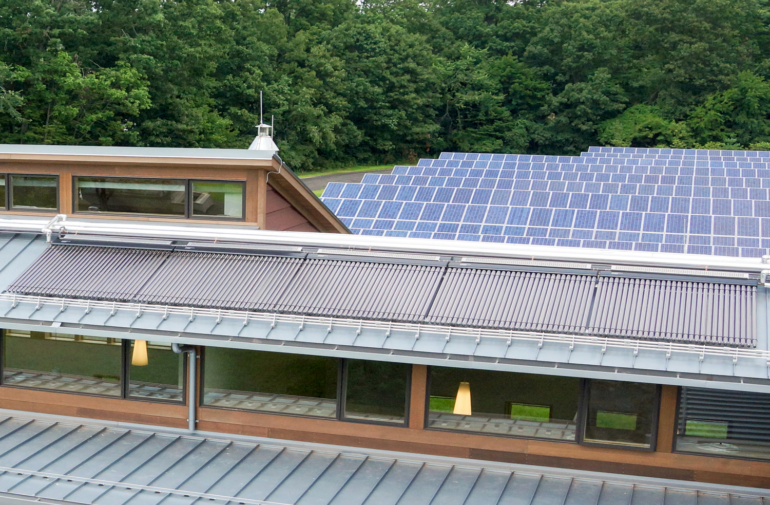 <p>Solar evacuated tube collectors supply domestic hot water. Excess hot water supplements the building's heating system.</p>